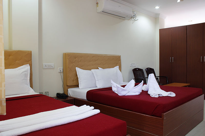 Triple Bed AC Room at Hotel Neem Tree, Hyderabad